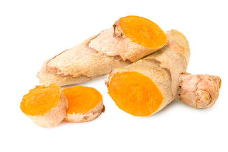 Turmeric root with turmeric slices isolated on white background