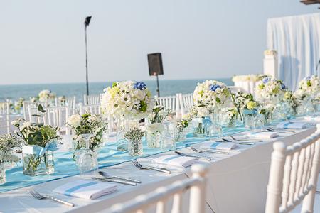 setup: Wedding table setup on the beach