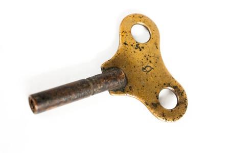 windup: Brass wind-up key Stock Photo