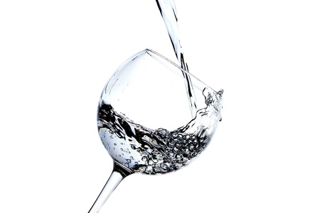 Splash of water in the glass on white background photo