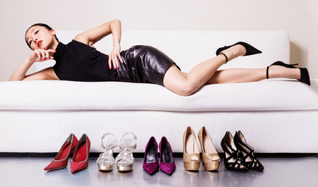 lie down: Beautiful asian woman with many shoes Stock Photo