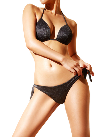 slim woman: Beautiful woman body with black bikini and sunglasses. isolated on white...