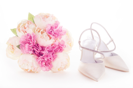 bride dress: bouquet and white wedding shoes isolated on white... Wedding bridal fashion image.