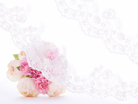 Lace curtain with A bouquet. Wedding invitation, lace veil textile. Foto de archivo