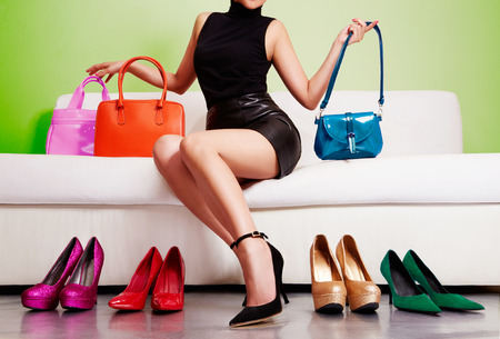 Legs and heels: Woman shopping colorful bags and shoes.
