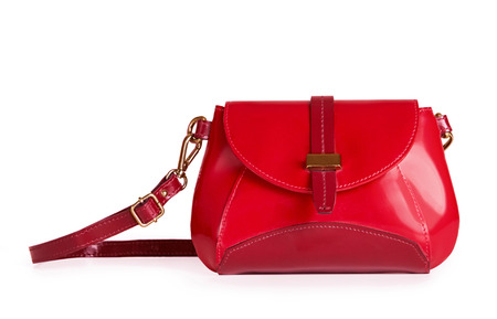 Beautiful leather red bag isolated on white background.