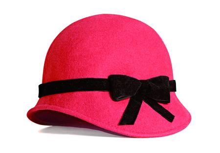 白い背景に分離された赤のエレガントな女性の帽子。マスクの形状。冬ファッション アイテムのイメージ。