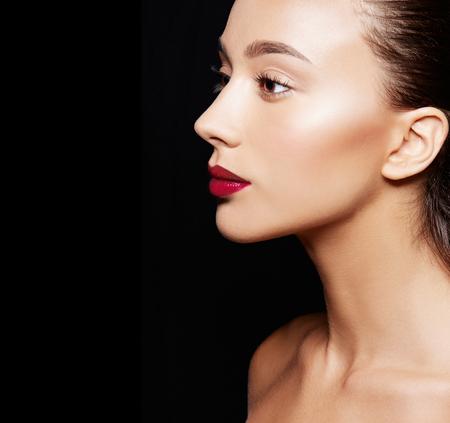 Beautiful woman on black background Standard-Bild