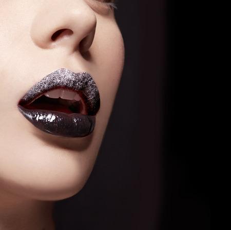 Silver metalic lipgloss. Artistic beauty makeup.
