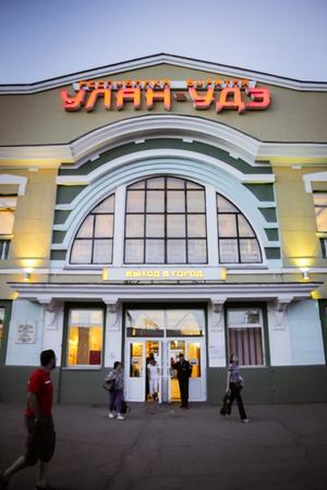 ulan ude: Ulan Ude, Russia - August 13, 2014: People are entering Ulan Ude main building at dusk.