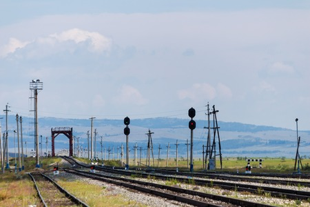 Railroad tracks with railway station photo