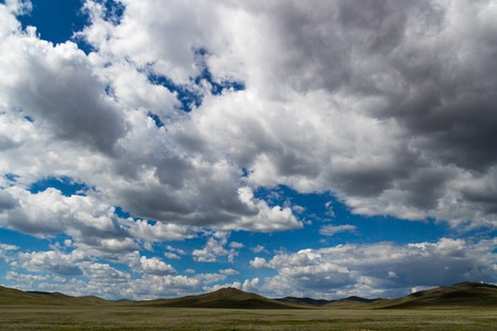 Beautiful view on mongolian steppes with clouds photo