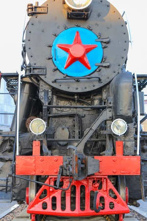 Red and Black colored Soviet steam locomotive photo
