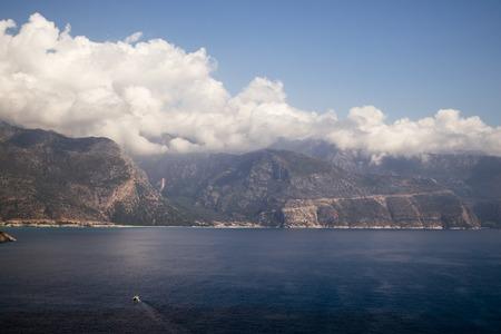 Mini Beach in Rugged Mediterranean Coastline photo