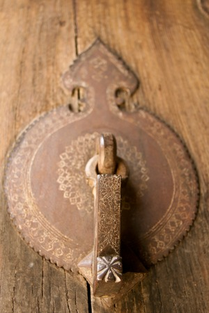 Ancient iron door handle, selective focus photo