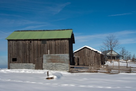 Green Cabin. Open sky with snow at plateau. photo