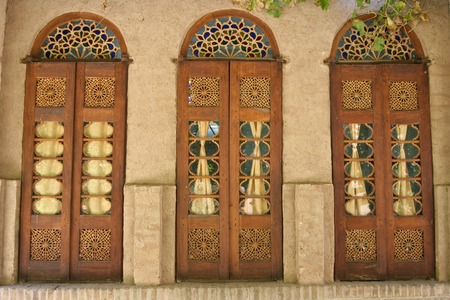 A door decorated in arabic style in Iran photo