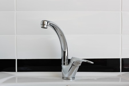 Modern chrome metal tap fitting photo