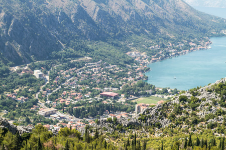 The sun beams light the Kotor bay and green mountains, Montenegro. photo