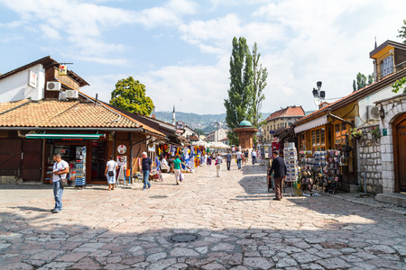 Sarajevo, Bosnia and Herzegovina - July 21, 2013: Sunny day in Bascarsija,main street of Sarajevo,cultural and historical center of the city. Souvenir shops and lot of tourists are exploring around.