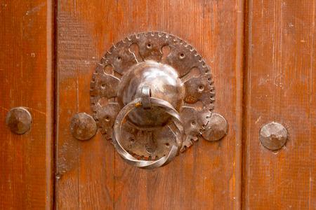 The lead oldstyle doorknob at wooden door photo