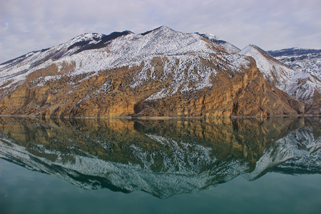 The reflection of the snowy mountains in the Tortum lake is wonderful Reklamní fotografie