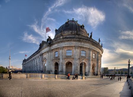 bode: Walking people on the bridge in front of Bode Museum Berlin