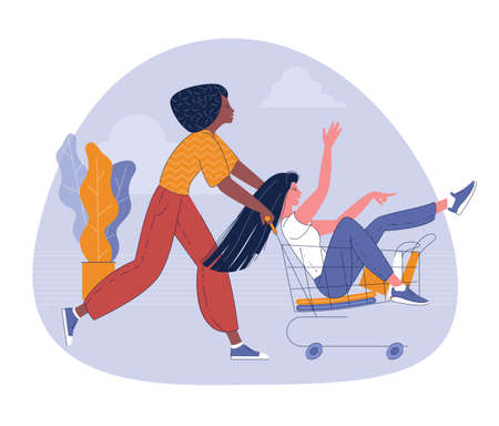 Girls riding supermarket cart