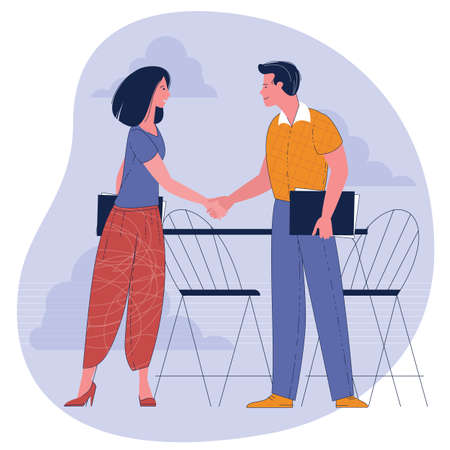 Businesswoman and businessman shaking hands.