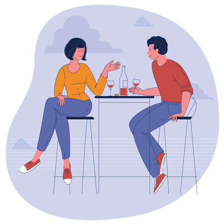 Man and woman drinking wine.