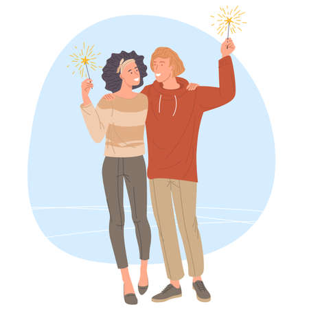 man and woman with sparklers in hand