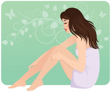 図床に座ってタオルで美しい若い女性