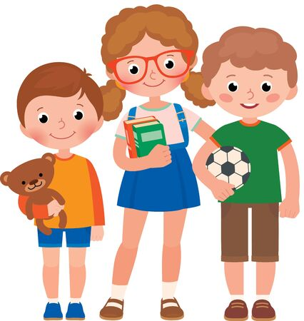 Three children, a little boys and a girl, pupils of elementary school or a preschool with a schoolbag, books and a toy