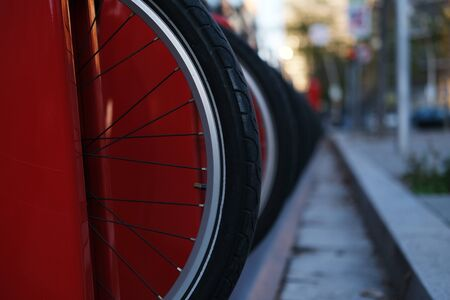 Horizontal photo of bicycle parking in autumn city close up Standard-Bild