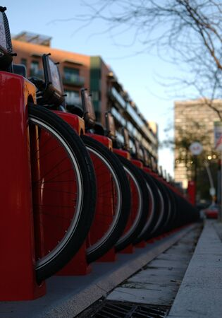 Vertical photo of a bicycle parking in a city close up