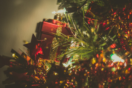 decoraton: Red Gift box on Christmas Tree blurrd background Stock Photo