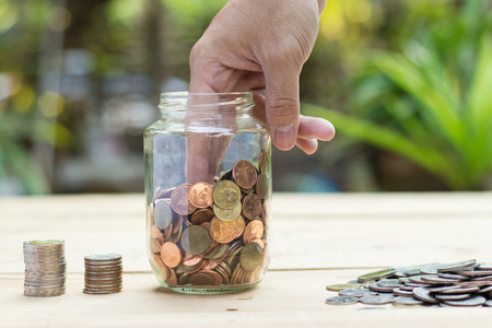 Hand-picked cent coins from piggy bank Stock Photo