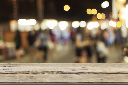 Wooden table on font image of blurred background, abstract