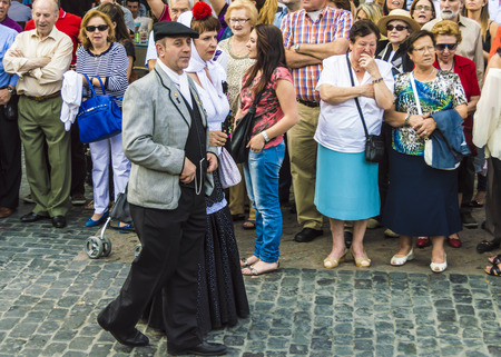 isidro: Madrid, Spain - May, 13, 2014: Typical people of Madrid in the procession in honor of Sant Isidro in Madrid