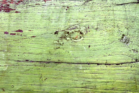 wood stain: old dirty green wooden wall