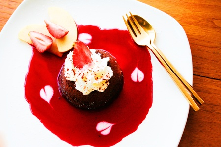 CHOCOLATE LAVA CAKE WITH STRAWBERRY SAUCE Stock Photo - 11176283