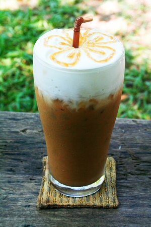 ice latte top with caramel sauce photo