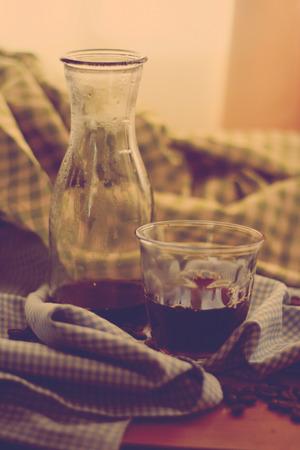 americano: hot americano drip coffee wirh plaid cloth , retro filter effect Stock Photo