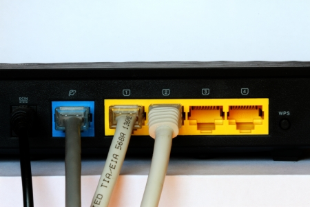 photo of the black small router with network cables photo