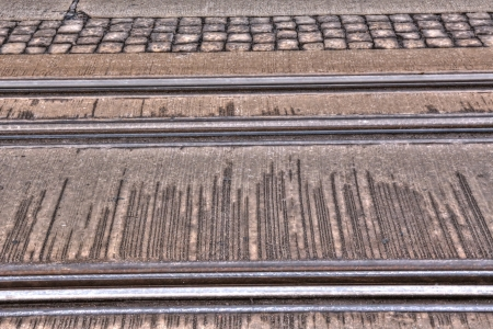 Photo of the tram Rails in the streets of city. 版權商用圖片 - 25238602