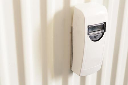 white radiator and radiator meter, photo Stock Photo