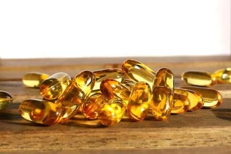 prophylactic: Dietary supplement pills on wooden desk