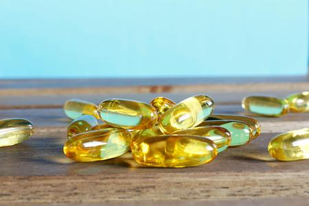 prophylactic: dietary supplement pills on wooden desk Stock Photo