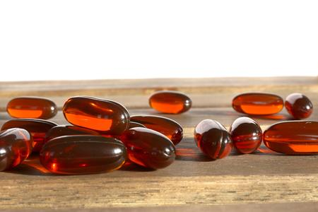 dietary: dietary supplement pills on wooden desk Stock Photo