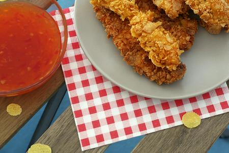 chilli sauce: chicken strips on plate and chilli sauce